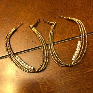 Large gold hoop earrings with rhinestone detail